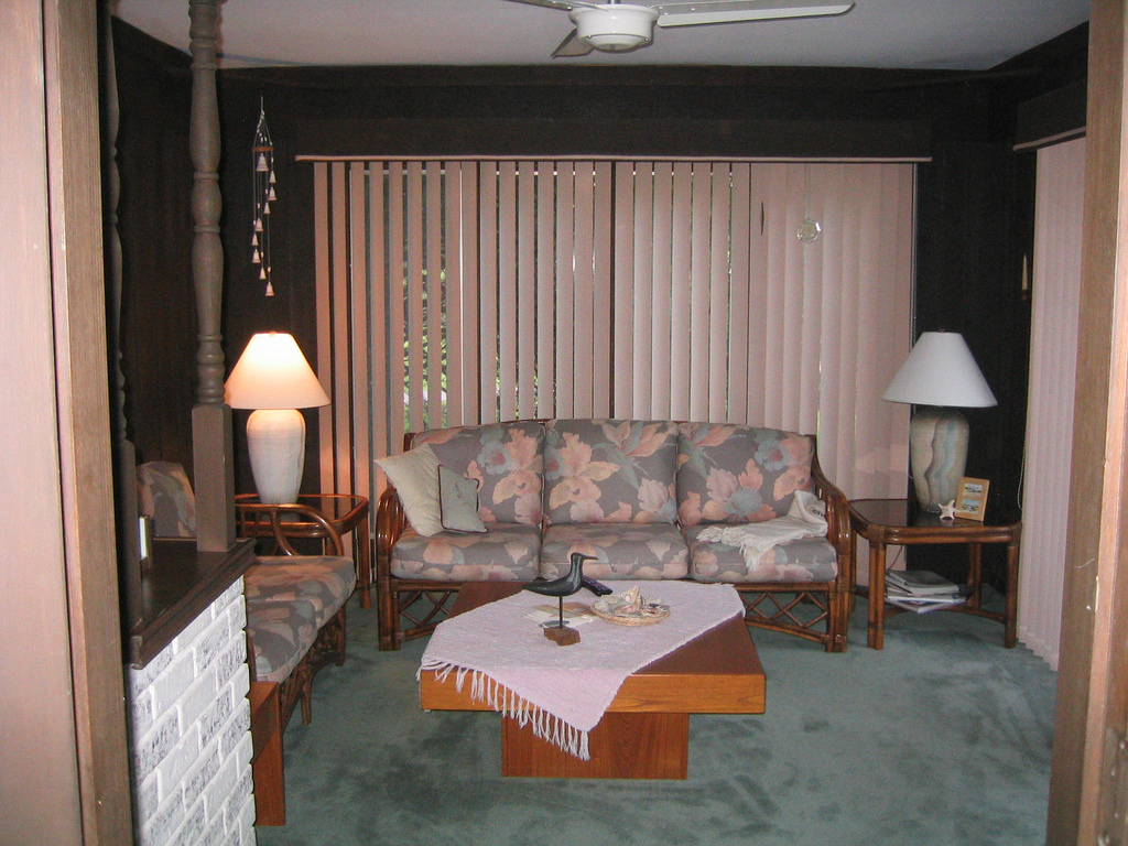 With vertical blinds and Jimmy Buffet-style decorating, this dreary living room was just asking for a makeover.