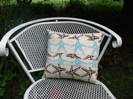 This Handprinted Starfish Pillow ($24) features a great starfish print on a cotton canvas pillow.