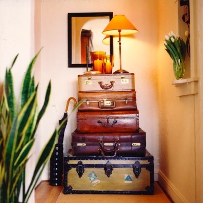 Use suitcases as a hallway table.  Source