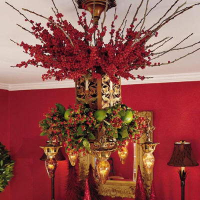 For instant holiday style, decorate an existing chandelier with berries and branches. Source