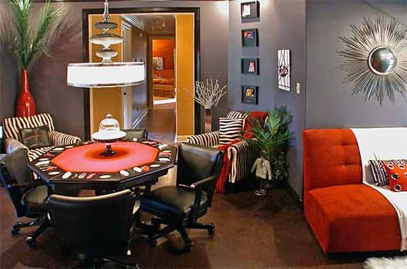 If you've decided to go bold and contemporary with wild prints, reds, shiny finishes, playful scale, and modern furniture, gray is a great background color to tone it all down. Source: Flickr User champagne.chic