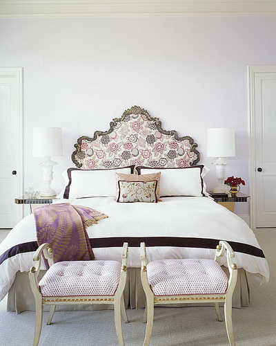 The palest of lavender on the wall coordinates with the pink and lavender textiles in this sophisticated bedroom.  Source:  Flickr User coco+kelley