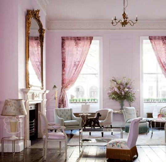This living room is feminine and dramatic, thanks to the deep pink curtains and pale lavender walls. The velvet tufted furniture doesn't hurt, either. Source