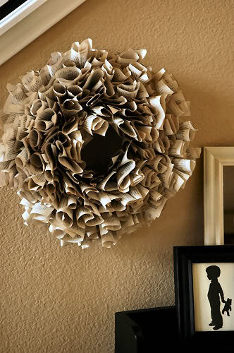 Blogger Living With Lindsay made this wreath by gluing pages of a dollar store book to a foam wreath.