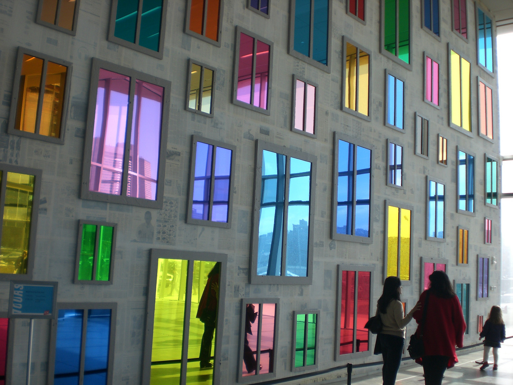 At the Institute of Contemporary Art in Boston, a wall of colored mirrors is a vibrant outdoor art installation. Source: Flickr User Leonard Chien