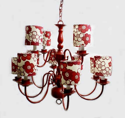 This Colonial Red Chandelier with Custom Lamp Shades ($210) is a total show-stopper. And, you can have it made it any color you choose!