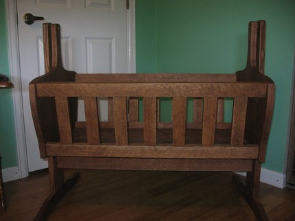 This gorgeous Wood Joinery Cradle ($500) is built from red oak with a walnut stain, and topped with an all natural beeswax finish. Simply stunning!