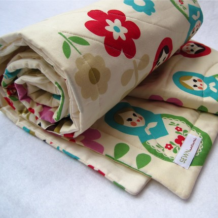 This Organic Matryoshka Doll Quilt ($110) is absolutely adorable, and it will match your matryoshka decor to a T!
