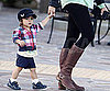 Slide Photo of Levi McConaughey Walking With Camila Alve's Hand