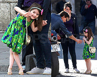 Photos of Suri Cruise in a Green Dress and Gold Shoes on Set of Knight & Day in Spain