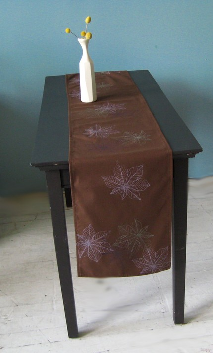 This chocolate brown Table Runner ($30) features a chestnut print. Use it instead of a tablecloth to showcase your dining table.