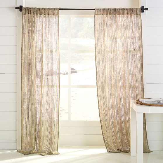 Get the look with the West Elm Open-Weave Silk Window Panel ($50-$90).