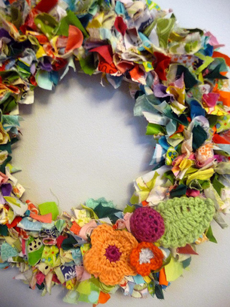 Use fabric scraps to create a colorful, unexpected wreath. You could definitely keep the color palette more restrained to create a holiday theme. Source