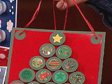 Make a hanging advent calendar from bottle caps.