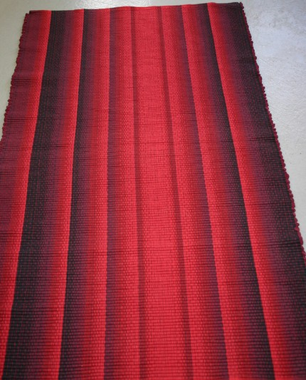 Red Wave ($125) is a handwoven cotton rug that will spice up your floors thanks to its chili-pepper color.