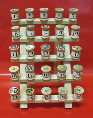 Make an advent calendar with notes and clues to send kids off on a hunt for presents with simple vintage spools.