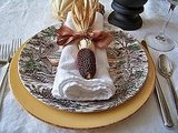 Lay an ear of Indian corn, tied with a ribbon, atop a napkin for a pretty and unusual table setting. Source