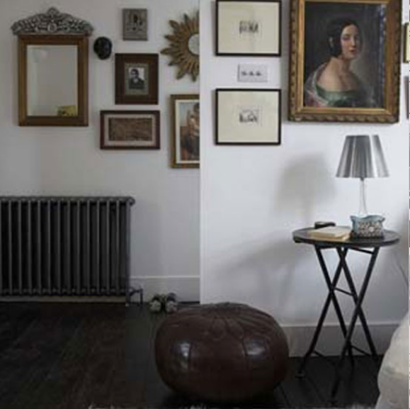 A leather Moroccan pouf provides the perfect telephone seat in this entry. Source