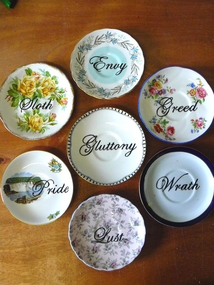 This Set of Seven Deadly Sins Plates ($140) was reworked from vintage English six-inch bone china saucers and handpainted in heat-fused ceramic paint, and is non-toxic and food-safe.