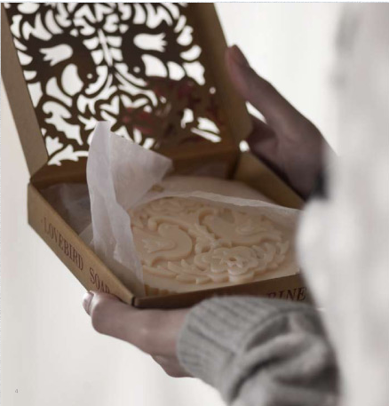 Even humble gifts look gorgeous when wrapped in a pretty package. Choose laser-cut boxes, vintage silk handkerchiefs, or other dramatic presentations for your small gifts.