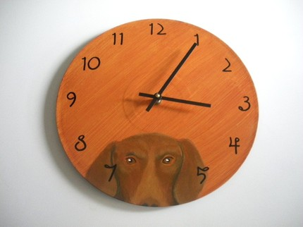 If someone in your life is a dachshund lover, she may appreciate this funny little Handpainted Wall Clock ($20).