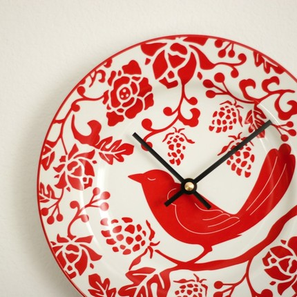 I love the color and pattern of this charming Aviary Clock ($27), which is made from a china plate.