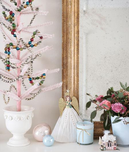 A bottlebrush-type pink tree gets bedecked with beads on this mantel. I love how feminine and pretty it is. Source