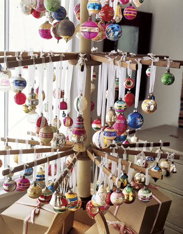 Hang ornaments from an antique drying rack to create an alternative Christmas tree. Source