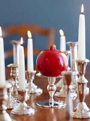 Use pedestal candle holders to lend height to beautiful, colorful fruit.  Source