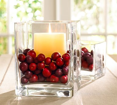 Use cranberries as a filler for your votives to bring a bit of color to the tabletop.