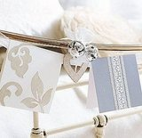 String cards and small ornaments onto the headboard or footboard of your bedframe. This would be especially cute for a guest bedroom. Source