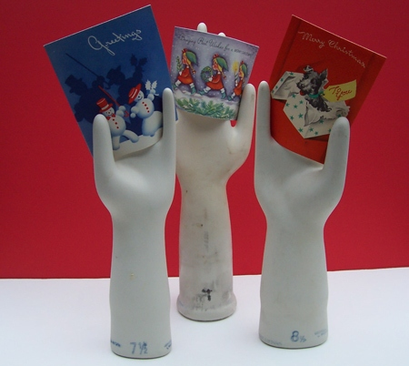 Use vintage glove models to hold your favorite cards, as Nibs did. Source