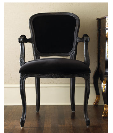 Even if it may be a bit dark, I can't help but adore this Velvet Armchair ($540).