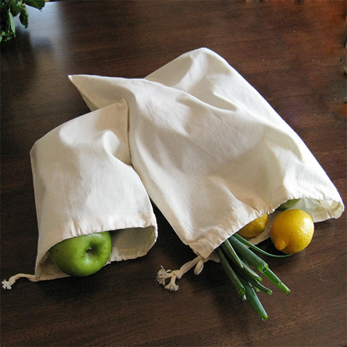 While many of us now carry reusable bags to the grocery store, most of us don't remember to bring reusable produce bags. You can buy organic cotton muslin produce bags and use them to wrap presents. Your gift recipient can then take these bags to the market after the holidays.