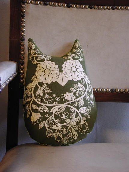 This Olive Owl Pillow ($28) would be cute in a children's nursery or could help to lighten up a more serious living room.