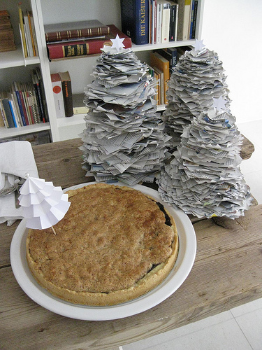 Upcycled newspaper trees are a really cute way to add eco cheer to a buffet or side table.  Source:  Flickr User th26987