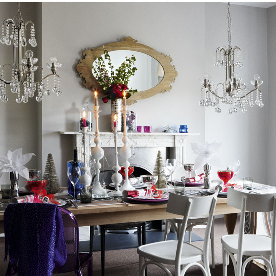 For a dinner party, you can switch the focus to the table but still leave some smaller ornaments and decorations on the mantel to continue the look.  Source