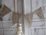 Simple and to the point, this 2010 Burlap Glitter Banner ($10) has understated elegance.