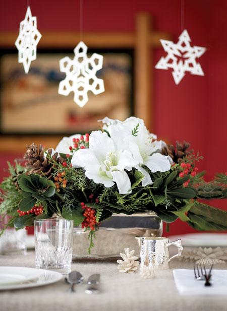 Make snowflakes with your kids, and then string them over your table.  Source