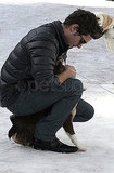 Photos of Zac Efron Playing With Dogs in Aspen
