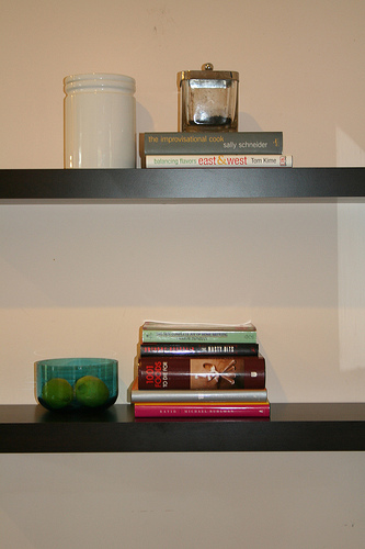 Open shelving provides a place for books and kitchen accessories.