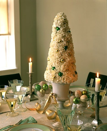 Martha created a fun, tree-shaped centerpiece out of carnations and holiday decorations.  Source