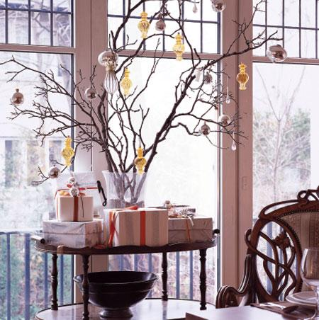 Bare branches look less austere when covered with metallic baubles.  Source