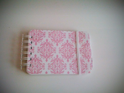 This Super Cute Mini Planner ($12) is perfect for small purses and very pretty in pink damask.
