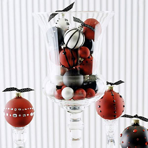 Fill a hurricane vase with ornaments of all shapes and sizes. Source