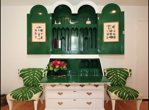 A secretary desk is a great way to maximize space. You can simply close it up when it's not in use. I love the green lacquer used on the interior of the desk in this Hollywood condo.
