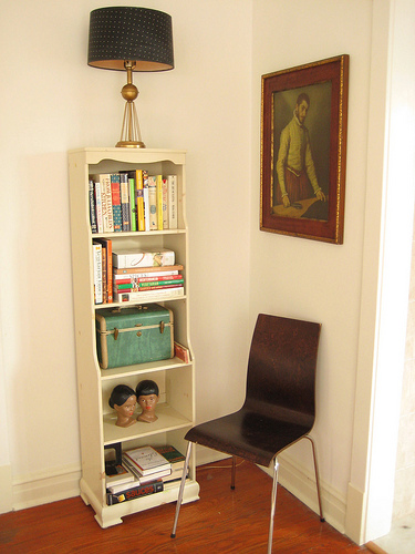 Bookshelves can work as part of a larger vignette in a room, and include elements such as art, lighting, and seating, to really add life and structure to the space. Source:  Flickr User back_garage