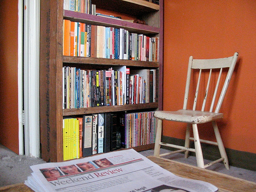 Keep books accessible to little tykes by putting children's books on lower shelves. Don't forget a kid-sized reading chair! Source:  Flickr User shoesfullofdust