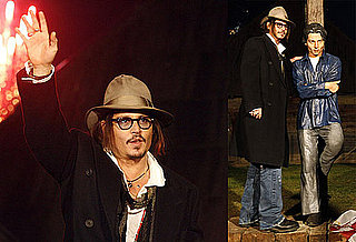 Photos of Johnny Depp Looking at a Bust of Himself in Serbia 2010-01-14 04:00:00