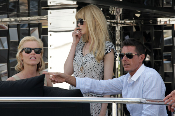 May 22: Eva Herzigova and Claudia Schiffer and Stefano Gabbana on his yacht, Regina D'Italia